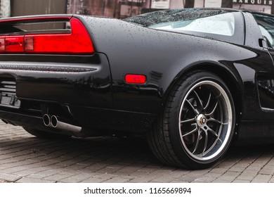Riga, Latvia - 04.04.2017. Black Honda / Acura NSX back with full red brake light.