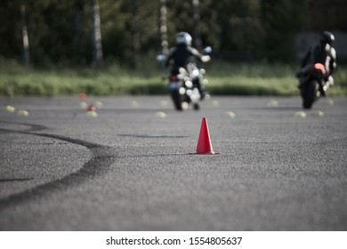 Riga, Latvia - 04.08.2019 Motocycle training day. Bikers have fun. Red road cone