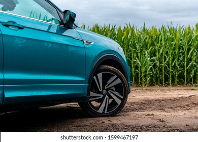 Riga, Latvia 11 September 2019 Volkswagen T-Cross is a subcompact crossover SUV 2019, Front wheel close up view from side, background corn field, summer sunset mood.