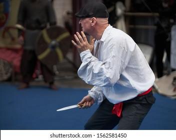 Riga, Latvia - 11.05.2019 - Assassin man with knife