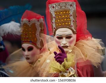 Riga, Latvia - 11.05.2019 Man in venetian mask showing finger