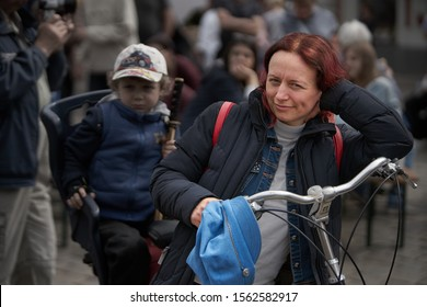 Riga, Latvia - 11.05.2019  - Woman with bicycle