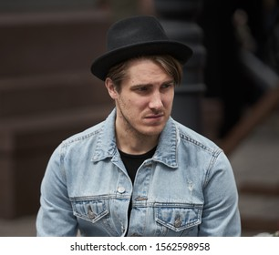 Riga, Latvia - 11.05.2019 young man in black hat