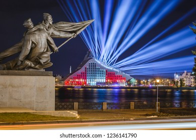 """Riga, Latvia, 11.18.2018  Light festival """"Staro Riga"""". National library of Latvia glowing in colorful lights creating a festive atmosphere. Modern architecture in vivid lights."""