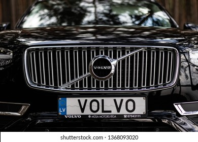 Riga, Latvia 12 April 2019 The Volvo XC90 is a mid-size luxury crossover SUV , stand in forest front logo view details plate Volvo name
