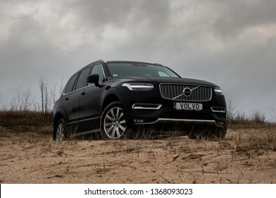 Riga, Latvia 12 April 2019 The Volvo XC90 is a mid-size luxury crossover SUV , stand on sand hill like a king