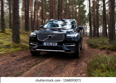 Riga, Latvia 12 April 2019 The Volvo XC90 is a mid-size luxury crossover SUV driving in forest motion blur with Volvo plate