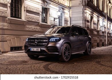 Riga, Latvia 12 April 2020, Mercedes-Benz third generation, X167, GLS-Class SUV, front view. Biggest Luxury crossover in Europe 2021 Stands on parking slot by luxury hotel at night time background.