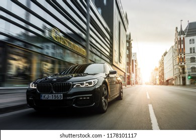 Riga, Latvia 12 September 2018, BMW 750 M Sixth generation G11driving on street in centre of city with sun flare at background