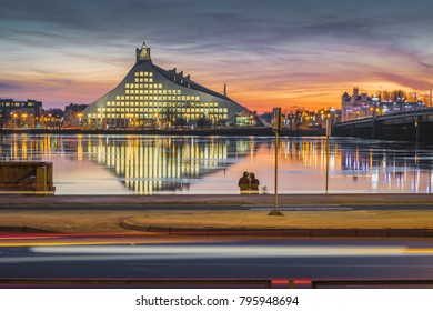 Riga, Latvia. 13th of January, 2018. Brand new Latvian National Library at a colorful sunset. Pinacle of modern architecture located right next to river Daugava.