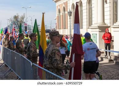 Riga, Latvia. 14 May 2017. International Rigas marathon 2017. Military with flags.