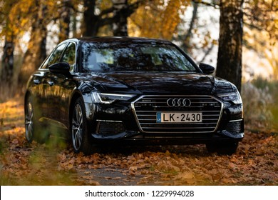 Riga, Latvia 14 November 2018, Audi A6 S line C8 Fifth generation 2019 autumn leaves  background