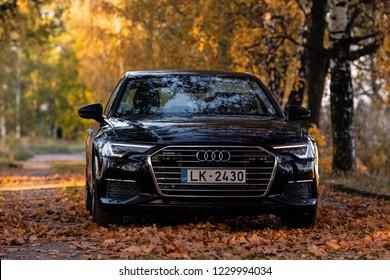Riga, Latvia 14 November 2018, Audi A6 S line C8 Fifth generation 2019 autumn leaves  background