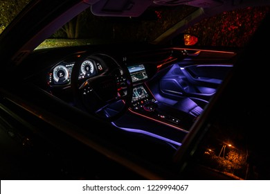 Riga, Latvia 14 November 2018, Audi A6 S line C8 Fifth generation interior dashboard navigation and wheel at night ambient light