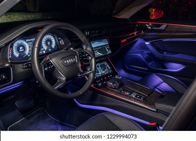 Riga, Latvia 14 November 2018, Audi A6 S line C8 Fifth generation interior dashboard navigation and wheel at night ambient light