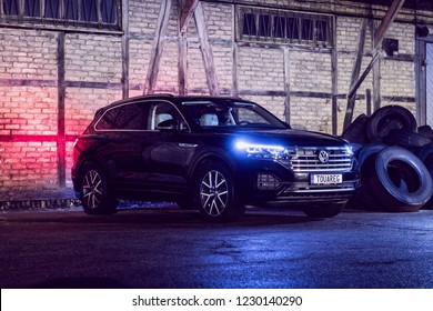 Riga, Latvia 14 November 2018, Volkswagen Touareg Third generation 2019 R line at night view cityscape