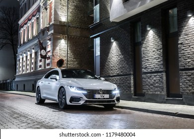 Riga Latvia, 14 September 2018 Volkswagen Arteon R Sport stands at night time cityscape background