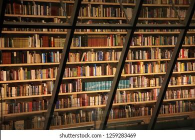 RIGA, LATVIA – 16 DECEMBER, 2018: Wall of books in Latvian National Library. Interior indoor.