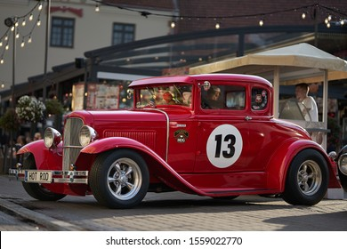 Riga, Latvia - 16.02.2019 Old car at Riga Streets. Retro car. Oldschool card. Red retro hot road. Vintage Cars bring crowd back in time to the '50s, , customs and restored vehicles filled the grounds