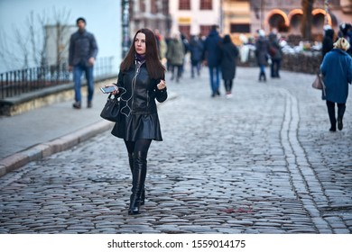 Riga, Latvia - 16.02.2019 Woman in black leather jacket  People at Streets