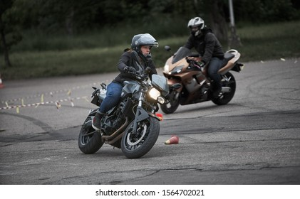 Riga, Latvia - 16.06.2019 Motorcycle gymkhana sport. A biker on a motorcycle.  Motorcycling. Motorcycle training. Motorcyclists ride through cones