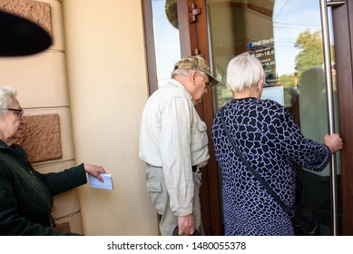 RIGA, LATVIA. 16th August, 2019. Seniors  looking into the window and trying to open doors at PNB Bank (formerly known as Norvik Bank). PNB Bank shut down after European Central Bank (ECB) announcment