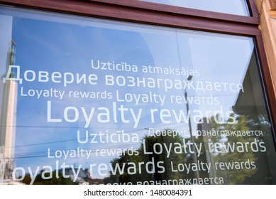 "RIGA, LATVIA. 16th August, 2019. Slogan ""Loyalty rewards"" on window of PNB Bank (formerly known as Norvik Bank). PNB Bank shut down after European Central Bank (ECB) announcment."