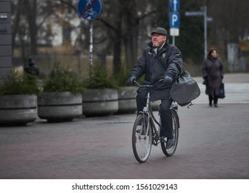 Riga, Latvia - 17.11.2018 man on bicycle in Riga