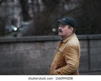 Riga, Latvia - 17.11.2018 portrait of a man  A man in a black cap