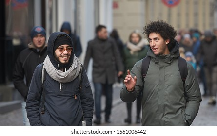 Riga, Latvia - 17.11.2018 two young guys talking about something