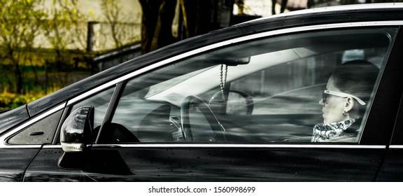 Riga, Latvia - 17.11.2018 woman in car. woman driving car
