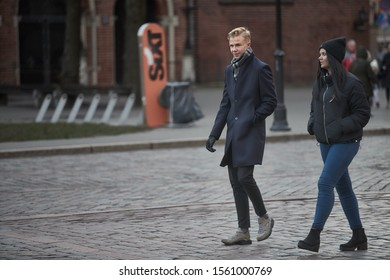 Riga, Latvia - 17.11.2018 young group at streets of Riga. City life in the downtown