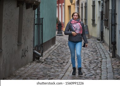Riga, Latvia - 17.11.2018 young woman in the city