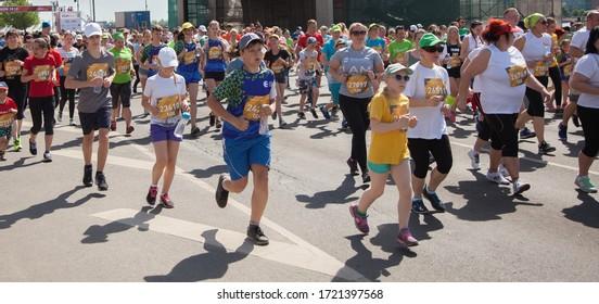 Riga, Latvia. 19 May 2019. Marathon runners on the distance.