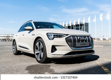 Riga, Latvia, 2 April 2019 Audi e-tron is a fully-electric compact luxury crossover SUV produced by Audi. Ready to drive in city backgound