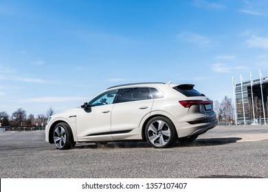 Riga, Latvia, 2 April 2019 Audi e-tron is a fully-electric compact luxury crossover SUV produced by Audi. Fast driving drifting in city backgound
