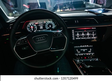 Riga, Latvia, 2 April 2019 Audi e-tron is a fully-electric compact luxury crossover SUV produced by Audi. Audi E-Tron first all-electric SUV, Interior view, wheel, dashboard.