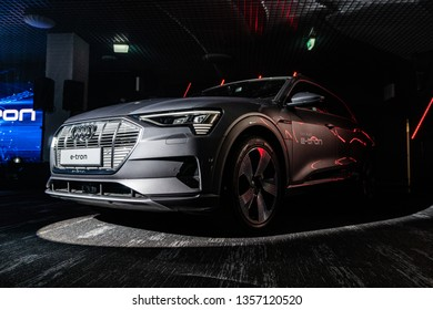 Riga, Latvia, 2 April 2019 Audi e-tron is a fully-electric compact luxury crossover SUV produced by Audi. Audi E-Tron first all-electric SUV car presented at the Riga Show