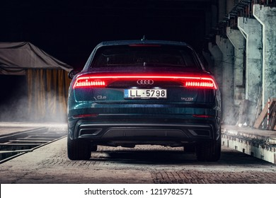 Riga, Latvia 2 November 2018 New AUDI Q8 50tdi in factory industrial landscape rear view with lights on
