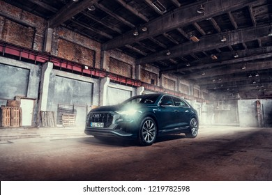 Riga, Latvia 2 November 2018 New AUDI Q8 50tdi in factory industrial landscape front view smoke at background