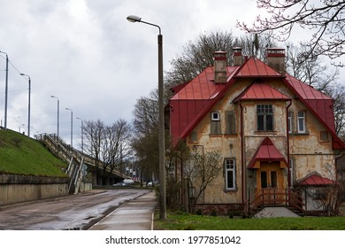 Riga, Latvia, 20.04.2021, two-storey house with a red roof