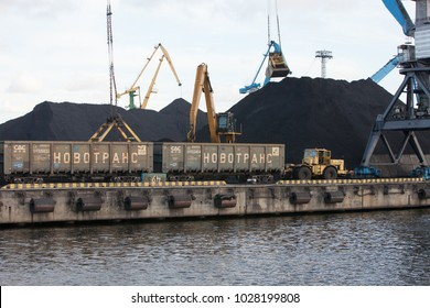 Riga, Latvia - 2015/26/09: Coal loding cranes unload train freight cars in Riga free port coal handling terminal