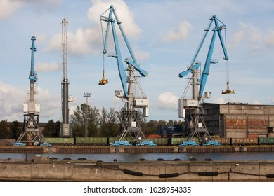 Riga, Latvia - 2015/26/09: Container loding cranes with spreaders in Riga free port central terminal