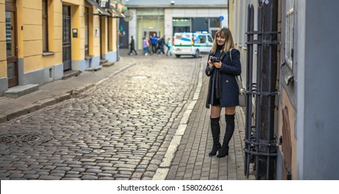 Riga, Latvia -2019 Beautiful Fashionable Woman Standing at street of old town