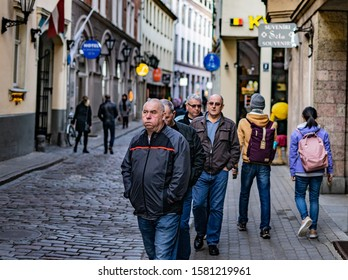 Riga, Latvia -2019 Group of elderly tourists on a sightseeing tour in Germany