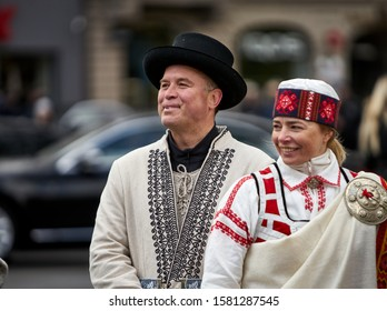 Riga, Latvia - 2019 man and woman in national costumes