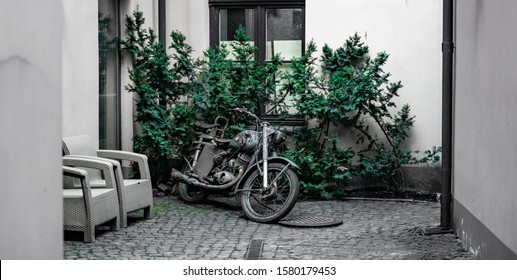 Riga, Latvia - 2019 old style motorcycle at the backyard of hose in old town