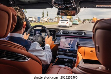 Riga, Latvia 21 July 2021 Limousine transfer chauffeur driving luxury car in cityscape. Private driver of Mercedes Benz S500 S class w223, view from rear seats.