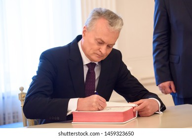 RIGA, LATVIA. 23rd of July, 2019. President of Lithuania, Gitanas Nausėda signing the guestbook.