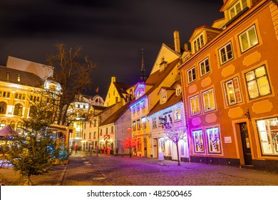RIGA, LATVIA - 25 DEC 2015. Bright night old town. Cafe and restaurants, holidays time.